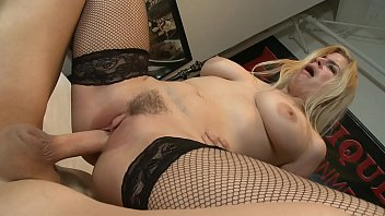 large-titted ash-blonde in fishnets on high high-heeled slippers.