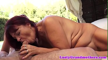 Redhead granny doggystyled outdoors
