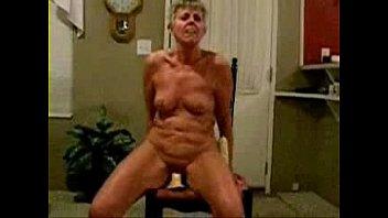 totally nude grannie railing a faux-cock
