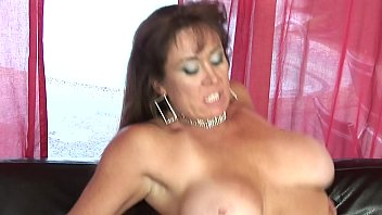 MILF with huge boobs sucks cock on her knees at home