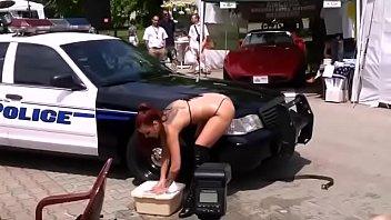 swimsuit carwash de-robe dance near police.