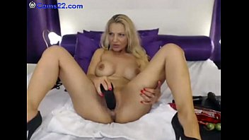 Busty milf masturbates with big black dildo on webcam